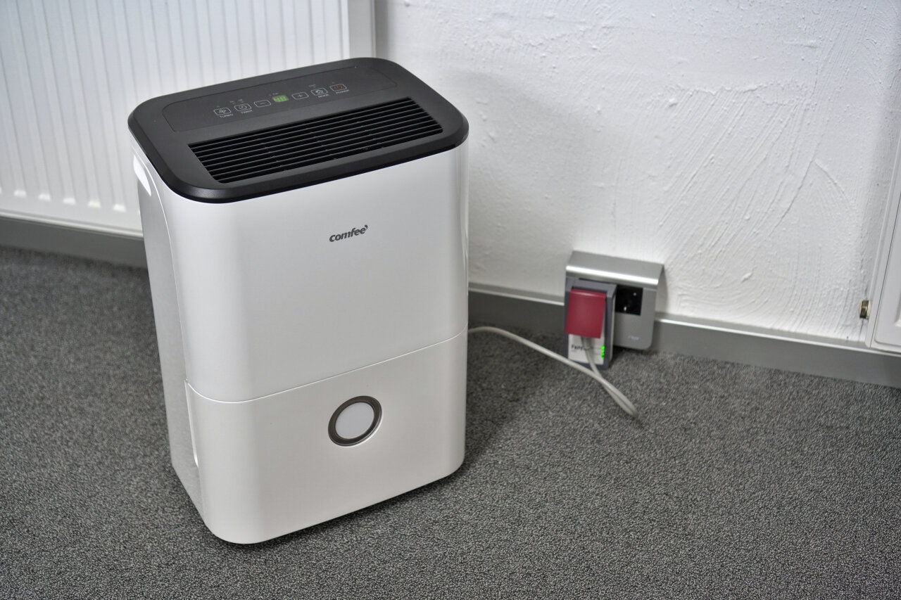 Image showing a dehumidifier and a power-outlet.