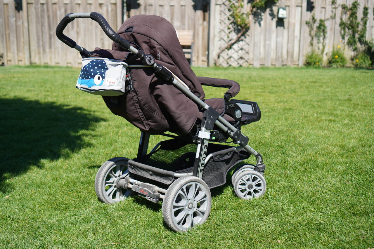 Baby stroller on a lawn.