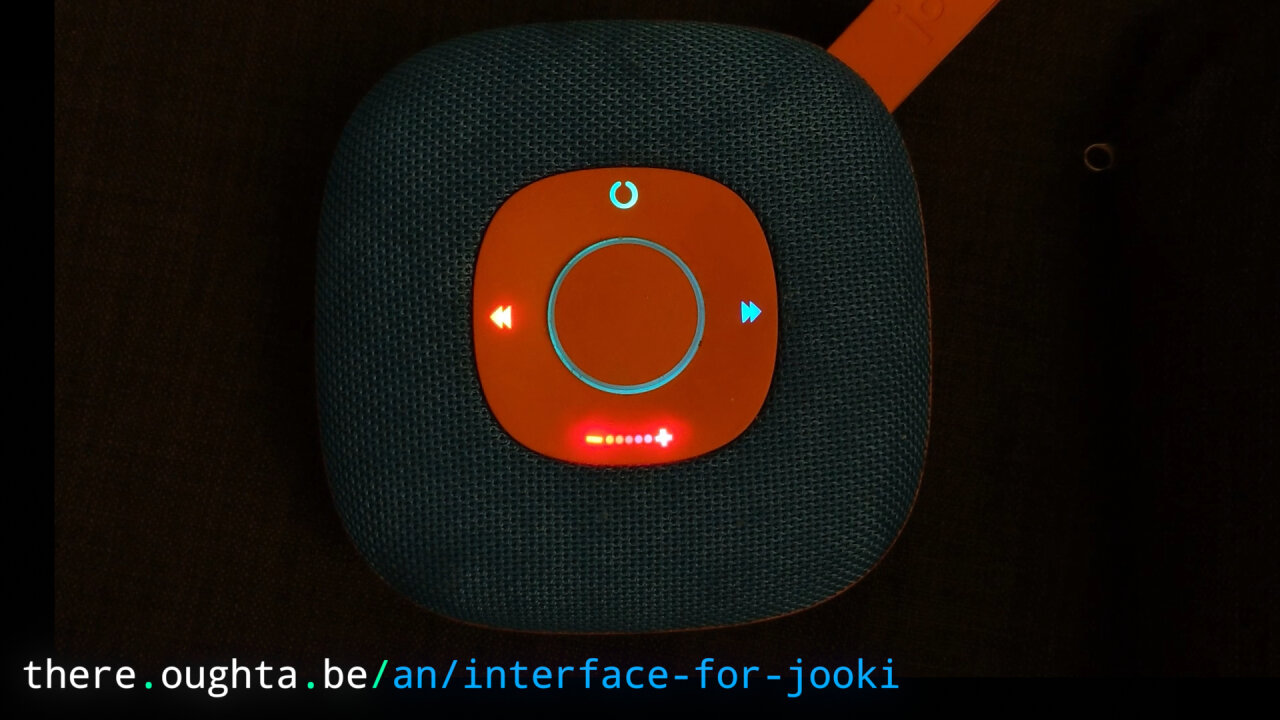 Thumbnail of a youtube video showing the Jooki with colorful glowing LEDs.