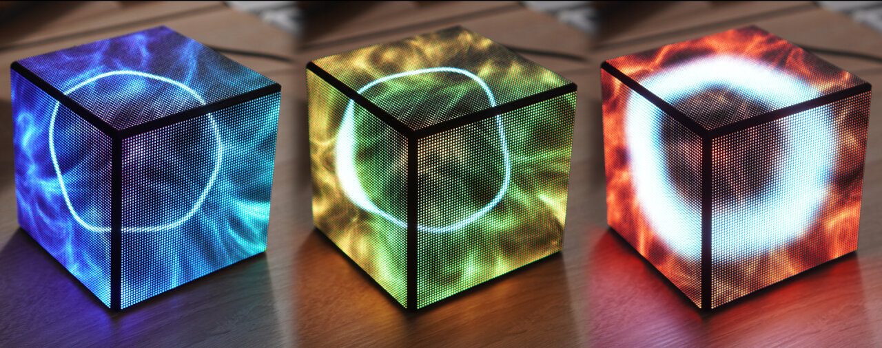 Three photo of my LED cube in different states from left to right. The left-most has a thin white ring on top of a blue-patterned background. The ring of the center image has a bulge at one side and the background is dominated by green and yellow colors. The photo on the right-hand side shows a cube with a very thick ring on a red background.
